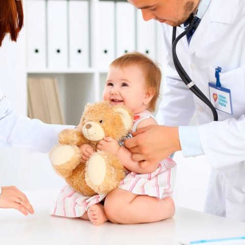 Two pediatricians treat a baby
