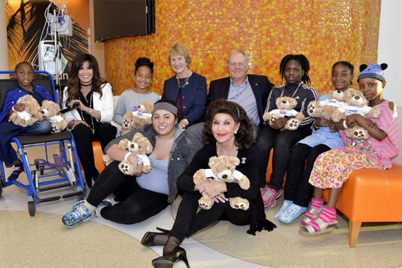 Barbara and Jack with families and golden teddy bears